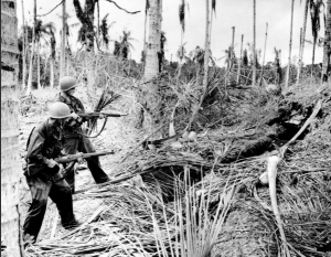 Soldiers flush out a Japanese hideout on New Guinea