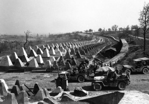 US Army pour through a breach in the Siegfried Line defenses, on their way to Karlsruhe, Germany