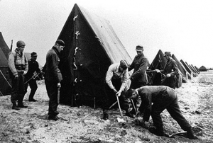 German POWs Erect Tents At Camp Tophat